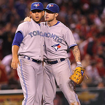 The Blue Jays' Brett Lawrie (right) congratulates teammate Henderson Alvarez on his first career shutout.  (Getty Images)