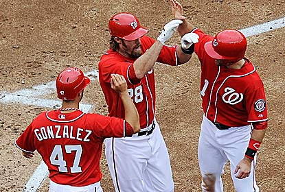 Jason Werth (center) hits a 3-run shot as one of the Nats' season-high three dingers as the team moves to 8-1 in series in '12. (Getty Images)