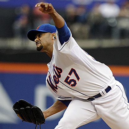 The Mets' Johan Santana allows three runs in seven innings to earn his first win since he beat the Braves on Sept. 2, 2010.  (AP)
