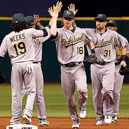 Jonny Gomes' (No. 31) 12-inning HR proves to be the winning run for the A's, ending the Ray's six-game winning streak.  (Getty Images)