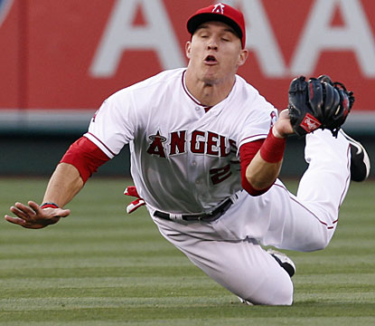 Mike Trout makes a diving catch off a fly ball and also hits his first homer in seven games. (AP)