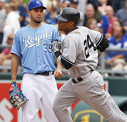 Robinson Cano rounds first in front of K.C.'s Eric Hosmer after clubbing his eighth career grand slam.  (AP)
