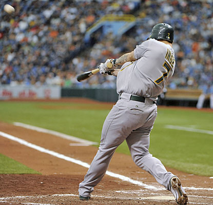 Brandon Inge connects for a three-run homer, his first since joining the A's, in the third inning.  (AP)