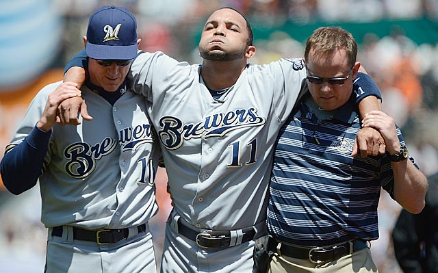 Four days after teammate Mat Gamel tears his ACL, Milwaukee's Alex Gonzalez hurts his knee. (Getty Images)
