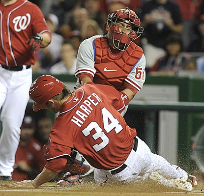 Washington's Bryce Harper gets the game off to a running start by stealing home in the bottom of the first inning.  (AP)