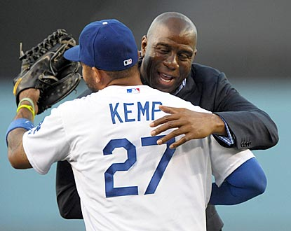 The Dodgers win Magic Johnson's first game as part-owner, thanks in part to Matt Kemp, who goes 3 for 3.  (US Presswire)