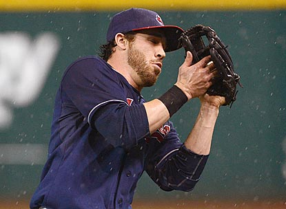 Indians second baseman Jason Kipnis battles the elements to catch Brent Morel's leadoff pop fly during the eighth inning.  (Getty Images)