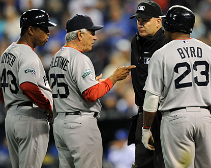 Bobby Valentine argues with the home plate umpire after Marlon Byrd was hit while attempting to bunt. (US Presswire)
