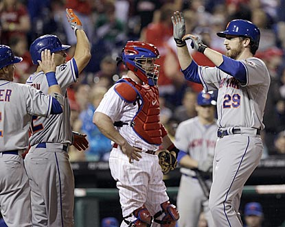 Ike Davis is greeted at home plate after breaking open the game in the eighth inning with a three-run circuit clout.  (AP)