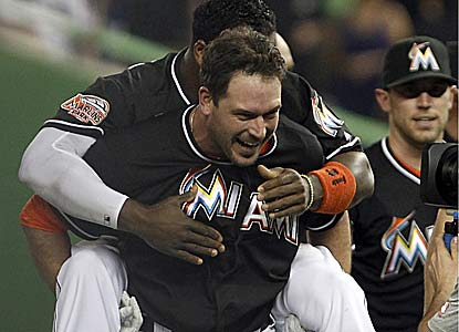 Greg Dobbs singles with two outs in the ninth to lift the Marlins to their ninth win in the past 10 games. (AP)