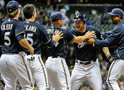 Teammates cheer Corey Hart (1) after his RBI single that gives Milwaukee the win over the Cubs. (US Presswire)