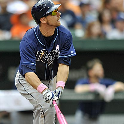 Ben Zobrist, who finishes with three RBI, watches his solo home run in the eighth inning of the Rays' victory.  (AP)