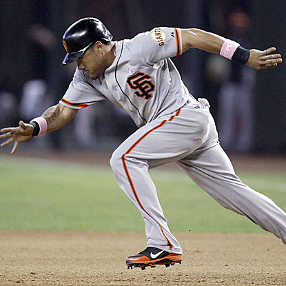 Melky Cabrera singles four times in the Giants' win, extending his hitting streak to 11 games.   (AP)