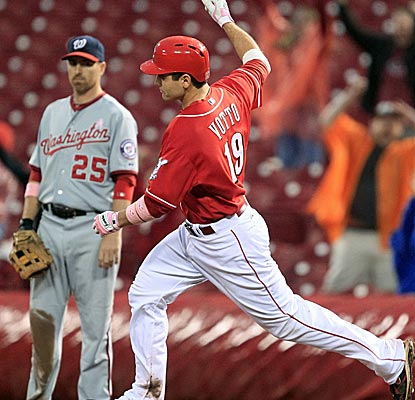 The Reds' Joey Votto hits three home runs, including a walk-off grand slam to beat the Nationals.  (AP)