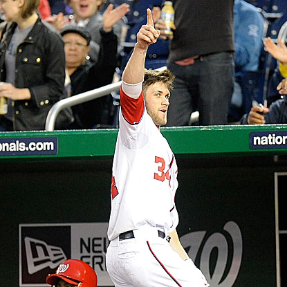 The Nats' 19-year-old phenom Bryce Harper salutes the home crowd after hitting his first career MLB home run.  (Getty Images)