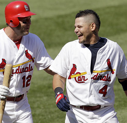 Lance Berkman congratulates Yadier Molina, who knocks in the winning run in the bottom of the ninth. (AP)