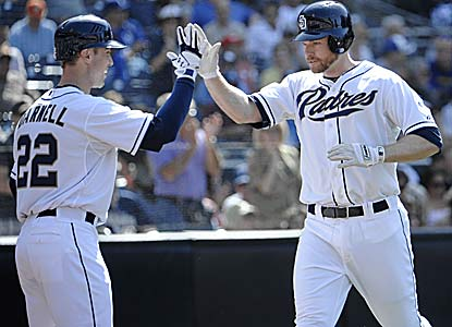 Chase Headley homers, doubles and drives in three as the last-place Padres get a rare win vs. the No. 1 team in the NL West. (Getty Images)