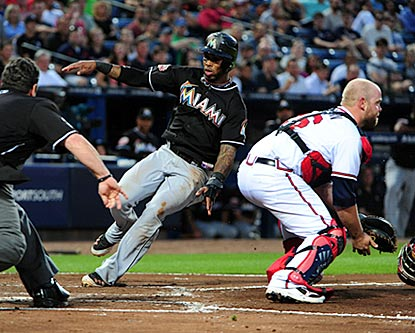 Jose Reyes slides past Brian McCann on a double steal in the fifth inning. It's Reyes' first career steal of home plate.  (Getty Images)