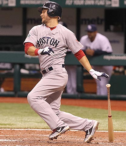 Cody Ross raps a two-out single in the eighth inning that pushes Boston's lead to 5-2.  (US Presswire)