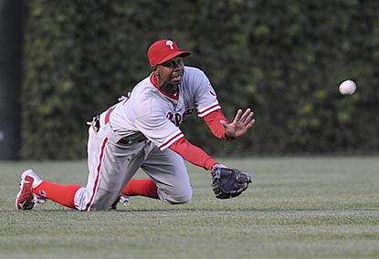 Juan Pierre helps out Roy Halladay with a diving catch that ends the first inning and saves a run.  (Getty Images)