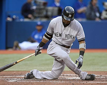 Robinson Cano, who drives in the Yankees' only run, gets twisted up after swinging and missing here.  (US Presswire)