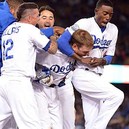 A.J. Ellis' bases-loaded walk in the ninth inning forces home the game-winning run for the Dodgers.  (Getty Images)