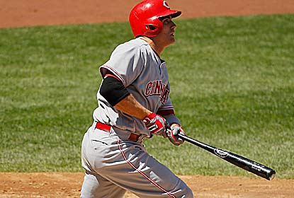 Joey Votto hits a three-run homer for the Reds, who overcome a 12-strikeout game by the Yanks' Ivan Nova. (Getty Images)