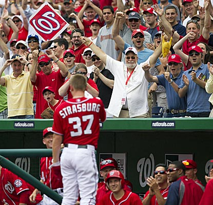 Almost embarrassed, Stephen Strasburg gets some love after hitting his first big-league homer.  (AP)