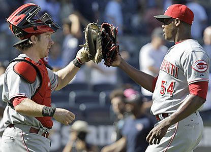 New Reds closer Aroldis Chapman (right) finishes off the slumping Yankees for his first save of the season. (AP)