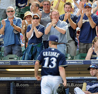 Brewers fans applaud Zack Greinke, who exits in the seventh and on his way to improve to 14-0 at Miller Park. (US Presswire)