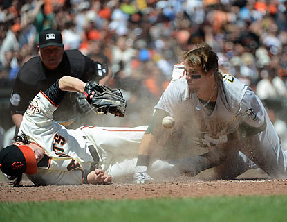 Tim Lincecum gets knocked around on the mound and takes a shot at home plate in the fourth, but finishes out the inning. (Getty Images)