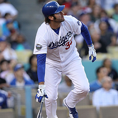 The Dodgers' Scott Van Slyke connects on a 3-0 pitch to launch a pinch-hit three-run homer, his first career round tripper.  (Getty Images)