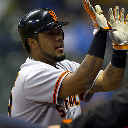 Hector Sanchez's lead-off homer in the top of the 14th inning snaps a 3-all tie in the Giants' win against the Brewers.  (US Presswire)