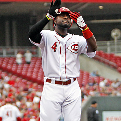 Brandon Phillips homers twice and drives in three runs for the Reds in their victory over the Braves.   (US Presswire)
