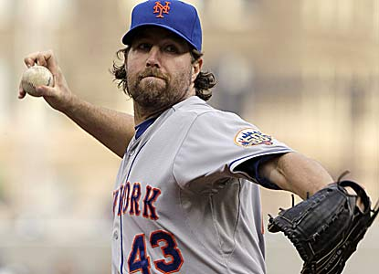 R.A. Dickey strikes out 11 without giving up a walk over seven innings for the win. (AP)