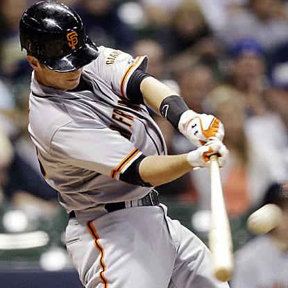 Buster Posey launches a HR off the Miller Park scoreboard and knocks in three runs in the Giants' win over the Brewers.  (AP)