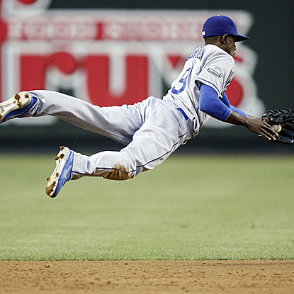 Dodgers shortstop Dee Gordon goes airborne to turn a game-ending double play to beat the Diamondbacks.  (AP)