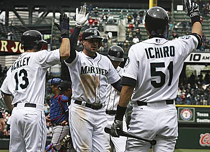 Alex Liddi (center) hits the first major-league grand slam by an Italian-born player since 1958 (Reno Bertoia).  (Getty Images)