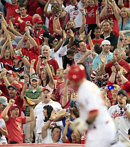 Reds fans go crazy as Devin Mesoraco rounds the bases following his first career grand slam. (AP)