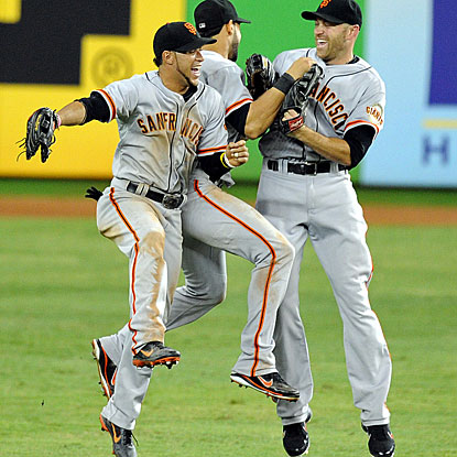 The Giants celebrate a rare offensive outburst against the Marlins with a season high in hits and runs.  (US Presswire)