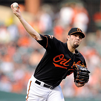 Jason Hammel pitches six strong innings for the Orioles, allowing no runs while striking out seven to earn the win.  (Getty Images)