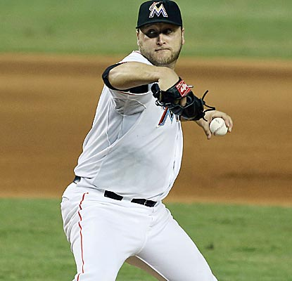 Marlins starter Mark Beuhrle scatters eight hits over 8 1/3 innings to earn his fifth win of the year.  (US Presswire)