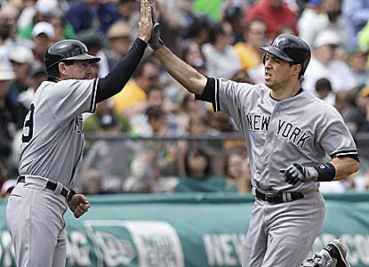 Mark Teixeira, receiving kudos from his third base coach Rob Thomson, finishes with a career-high 5 RBI. (AP)