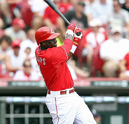 Brandon Phillips finishes 2 for 4 with a three-run home run to help the Reds edge the Rockies in a slugfest.  (Getty Images)