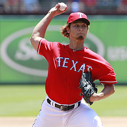 Yu Darvish surrenders three runs on seven hits in five innings of work but earns the win to improve to 7-2 for the Rangers.  (US Presswire)