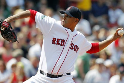 Boston starter Felix Doubront strikes out six in six innings of work to earn his fifth victory of the year.  (AP)