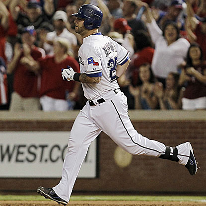 Mike Napoli's three-run homer in the sixth inning breaks a tie game and leads the Rangers past the Mariners.  (AP)