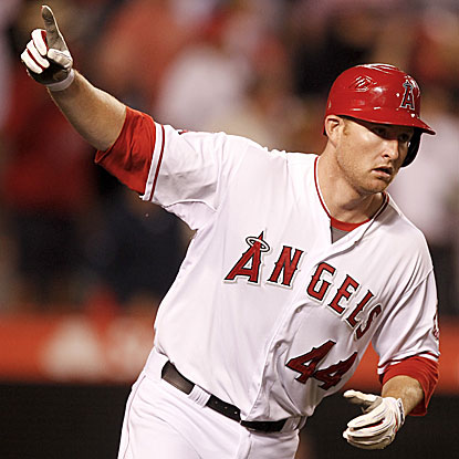 The Angels' Mark Trumbo doubles and triples before winning the game with a walk-off homer. (AP)