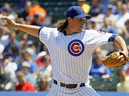 Jeff Samardzija gives up just three runs in seven innings of work against the Padres for his fifth win of the season. (AP)