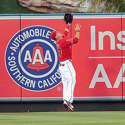 Mike Trout steals at least an extra-base hit from Nick Swisher with a great catch in the Angels' victory over the Yankees.  (US Presswire)